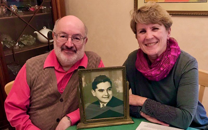 Robert & Diana Bangert-Drowns with a photo of Bob's uncle, Fr. Martin