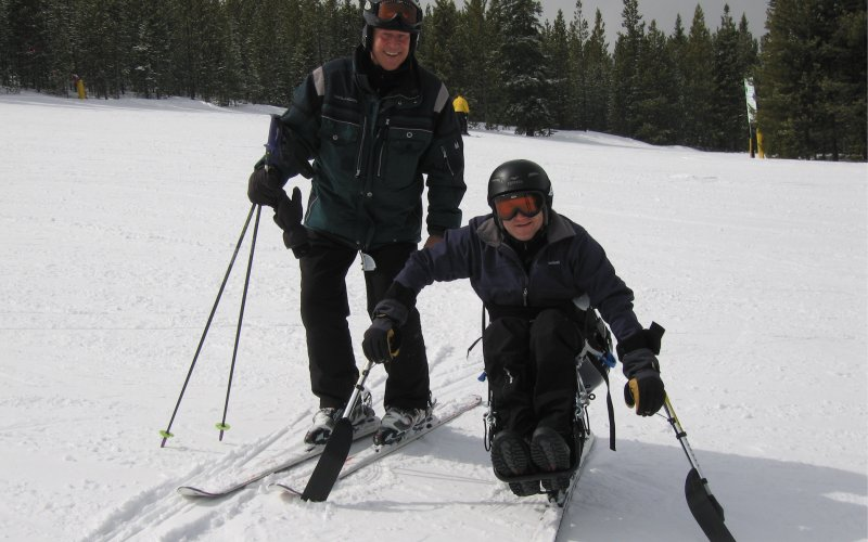 Ron Forbes skiing with son
