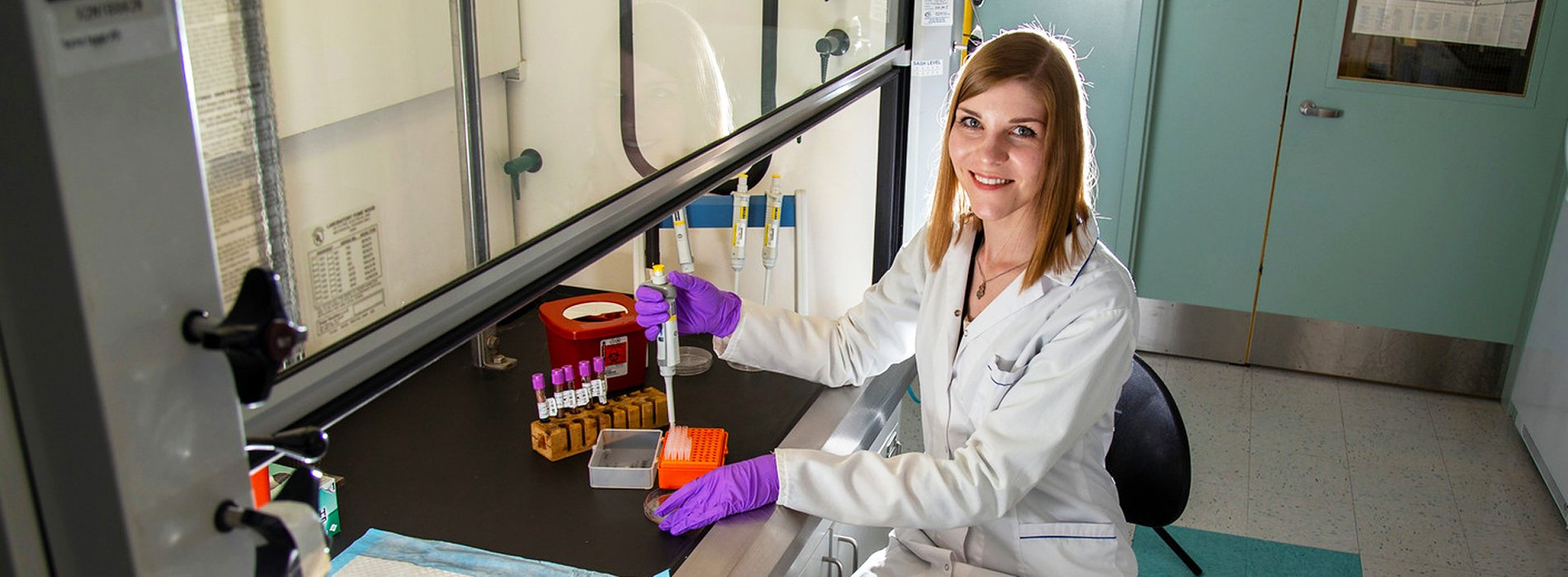 A UAlbany PhD student conducts research in a chemistry lab