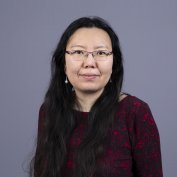 Dr. Xiaobo Xue Romeiko smiles at the camera.