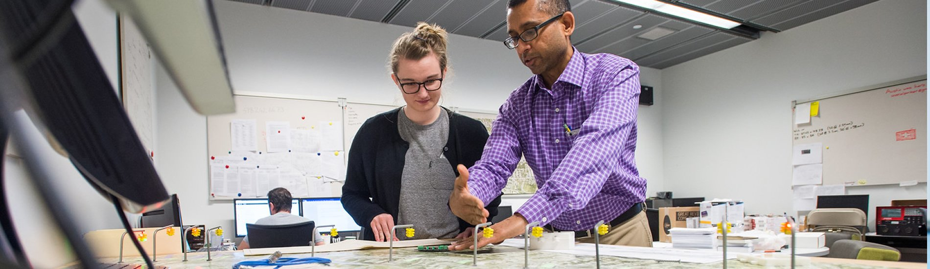 Student working with professor on traffic model