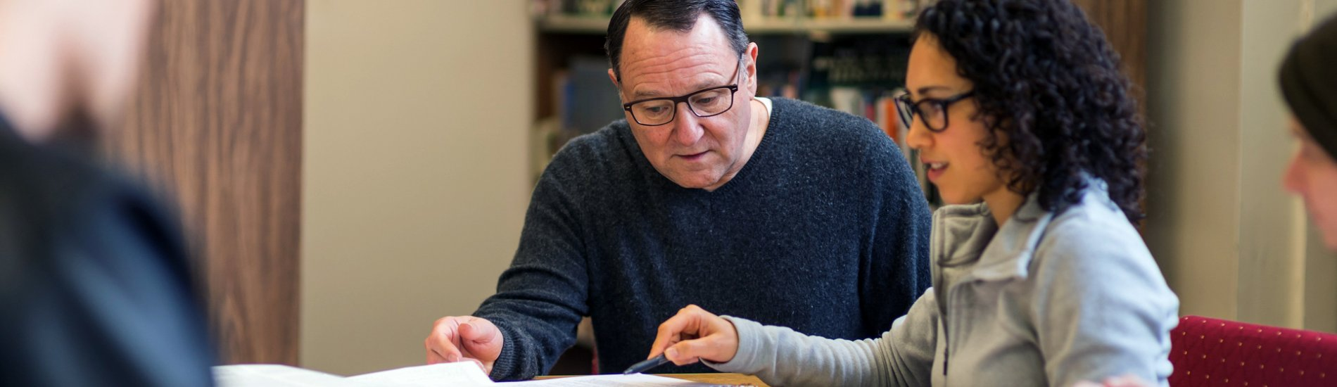 Mentor studying with students