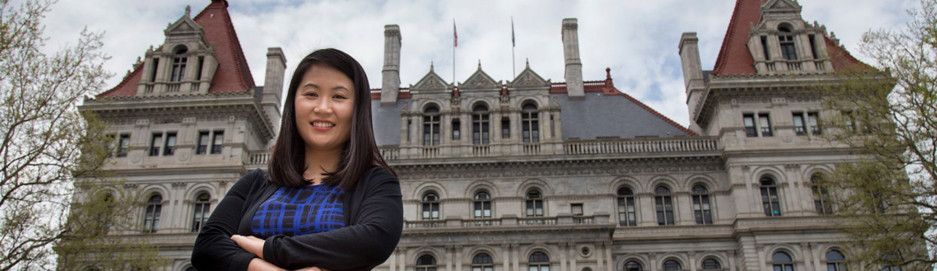 Doctoral student Sora Park in front of the New York State Capitol Building