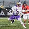 Connor Fields high-steps from a charging Stony Brook defender