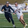 Frosh star Kendra Harbinger ball in stick outruns a Nittany Lion