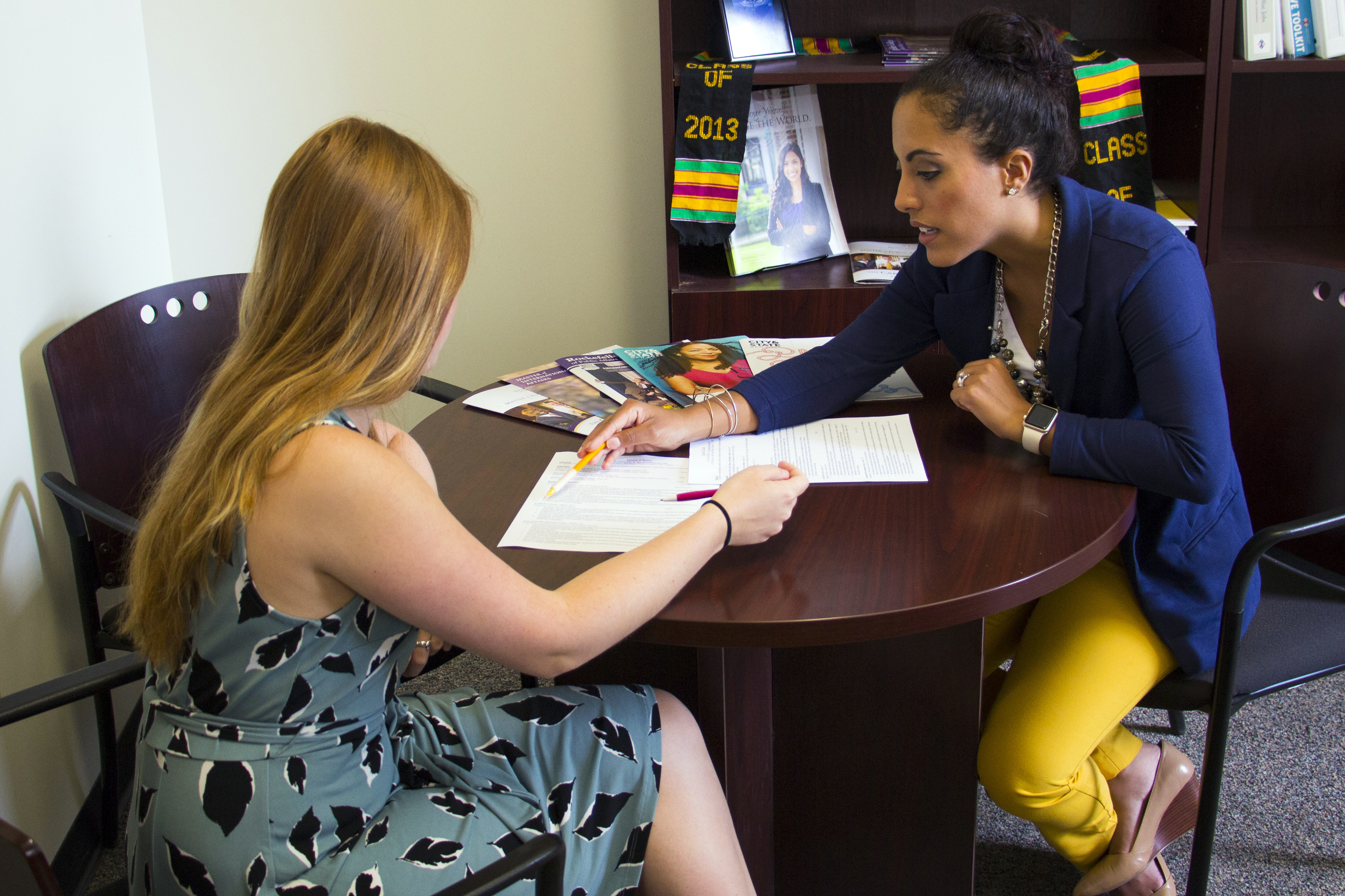 Yalitza Negron, Director of Internships and Career Services, consulting with a student