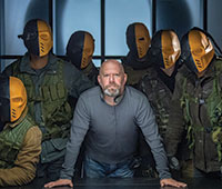 "Marc Guggenheim poses with the Makku Army from ""Arrow"""