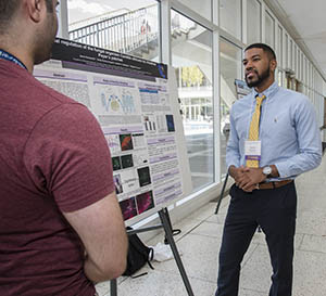 Two students talking at the Undergraduate Research Forum.