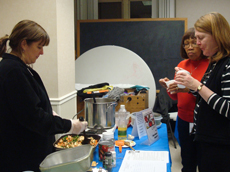 Audience enjoy food from Cornell Cooperative's cooking demonstration