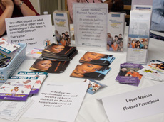 Upper Hudson Planned Parenthood displays a collection of brochures and other information about their services at the Women's Health Project's community event.